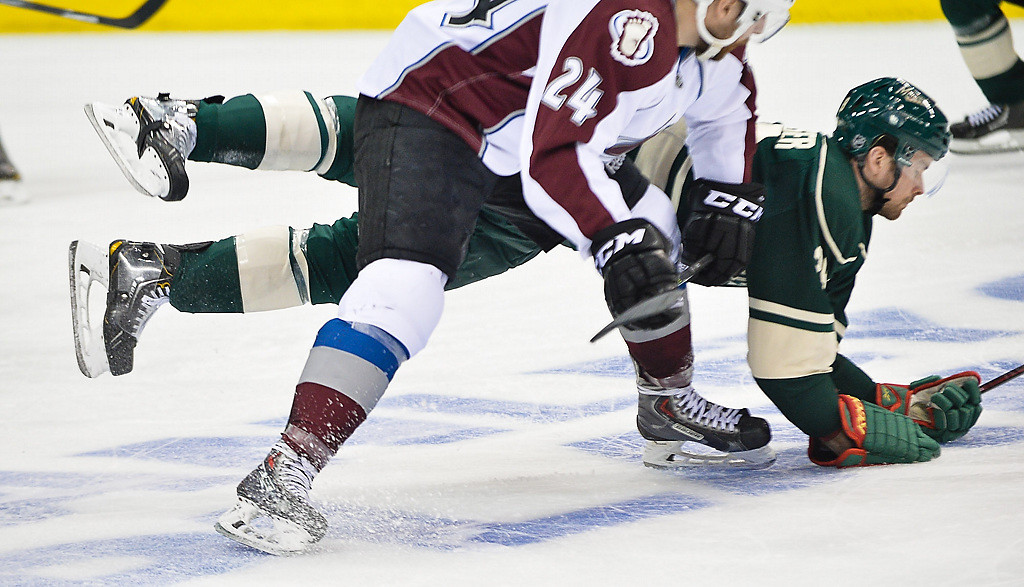 . Wild defenseman Nate Prosser gets tangled with Avalanche right wing Marc-Andre Cliche in the third period.  (Pioneer Press: Ben Garvin)