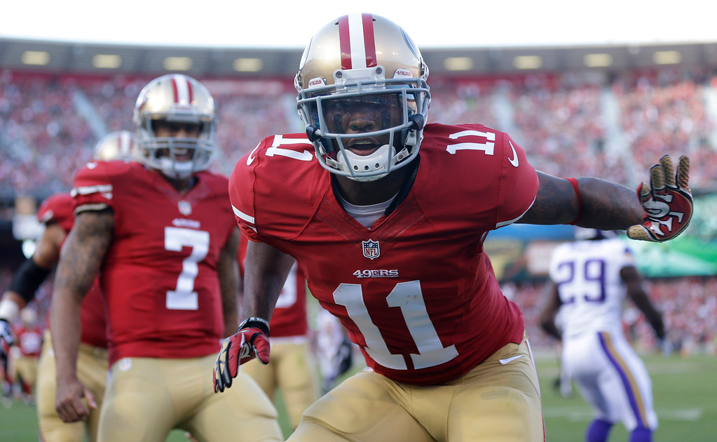 . 49ers wide receiver Quinton Patton  celebrates after scoring on a five-yard touchdown reception from quarterback Colin Kaepernick, left, during the first quarter against the Vikings. (AP Photo/Marcio Jose Sanchez)