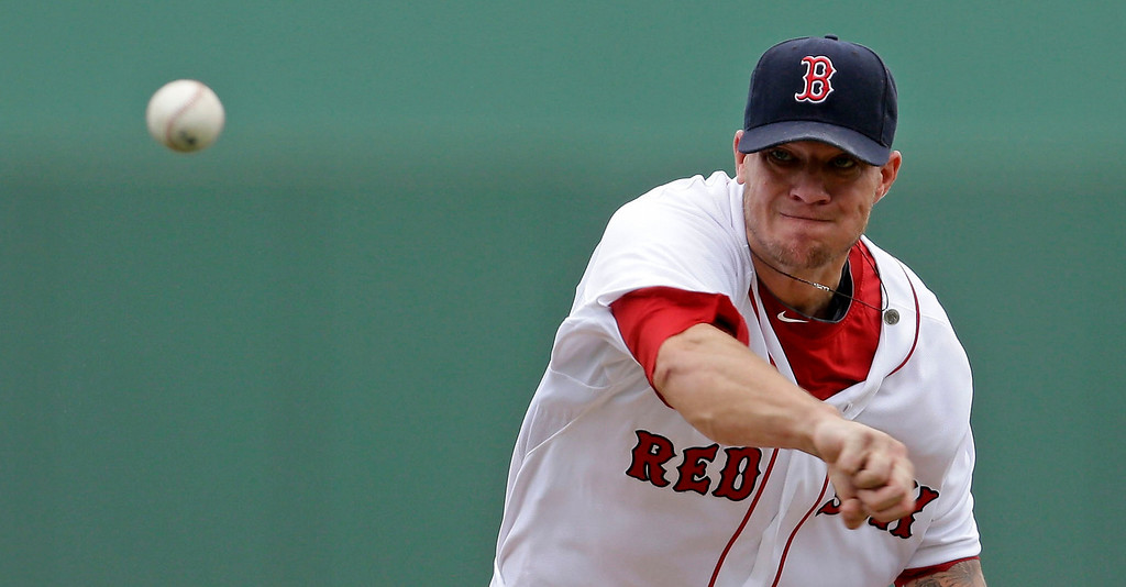 . Boston Red Sox starting pitcher Jake Peavy (44) pitches during the first inning of an exhibition baseball game against the Minnesota Twins in Fort Myers, Fla., Saturday, March 29, 2014. (AP Photo/Gerald Herbert)
