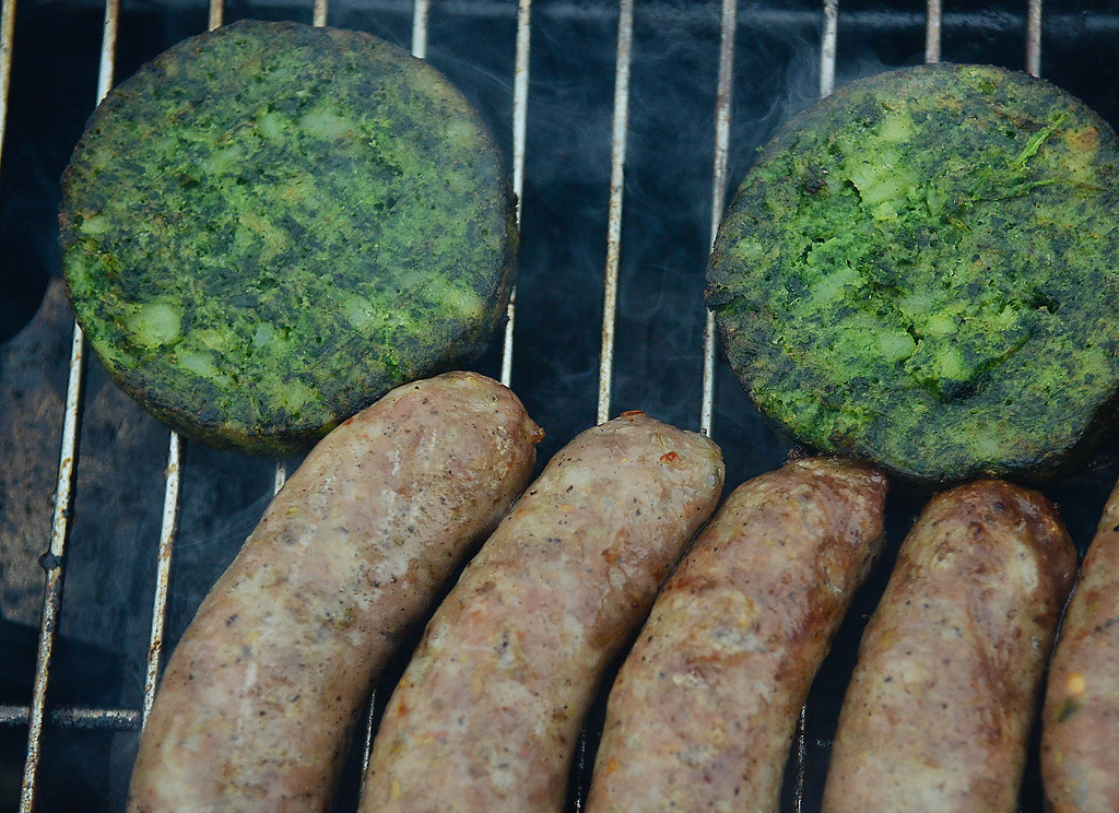 . Spinach burgers and organic brats were on the tailgating menu. (Pioneer Press: Ben Garvin)