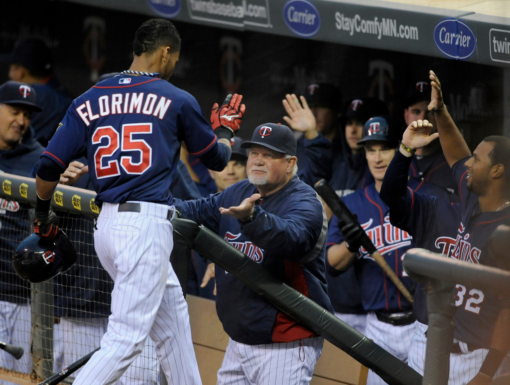 . Pedro Florimon of the Minnesota Twins is congratulated by manager Ron Gardenhire as he heads for the dugout after his two-run home run.  (Photo by Hannah Foslien/Getty Images)