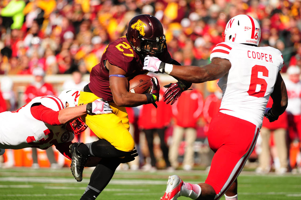 . Minnesota running back David Cobb ran for 138 yards on 31 carries, including this first quarter play. Defending for Nebraska are linebacker Jared Afalava, left, and safety Corey Cooper.  (Pioneer Press: Scott Takushi)