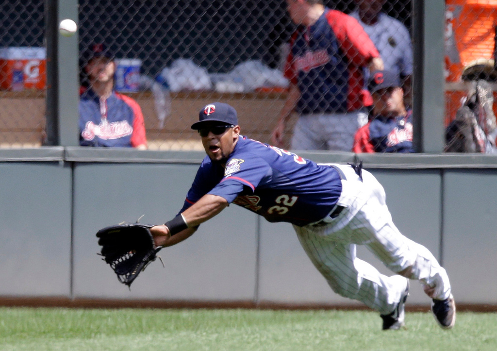 . Twins center fielder Aaron Hicks dives to make a catch on a soft linerl off the bat of Cleveland\'s Asdrubal Cabrera in the third inning. (AP Photo/Jim Mone)