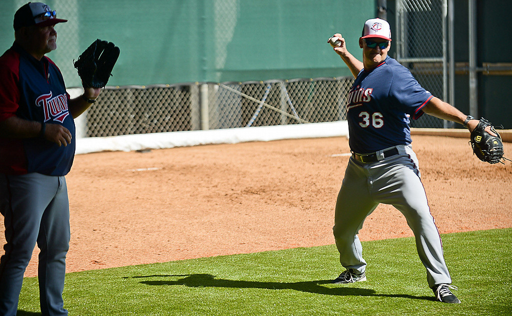 . Bench coach Terry Steinbach, right, warms up with catchers. At left is Twins manager Ron Gardenhire. (Pioneer Press: Ben Garvin)