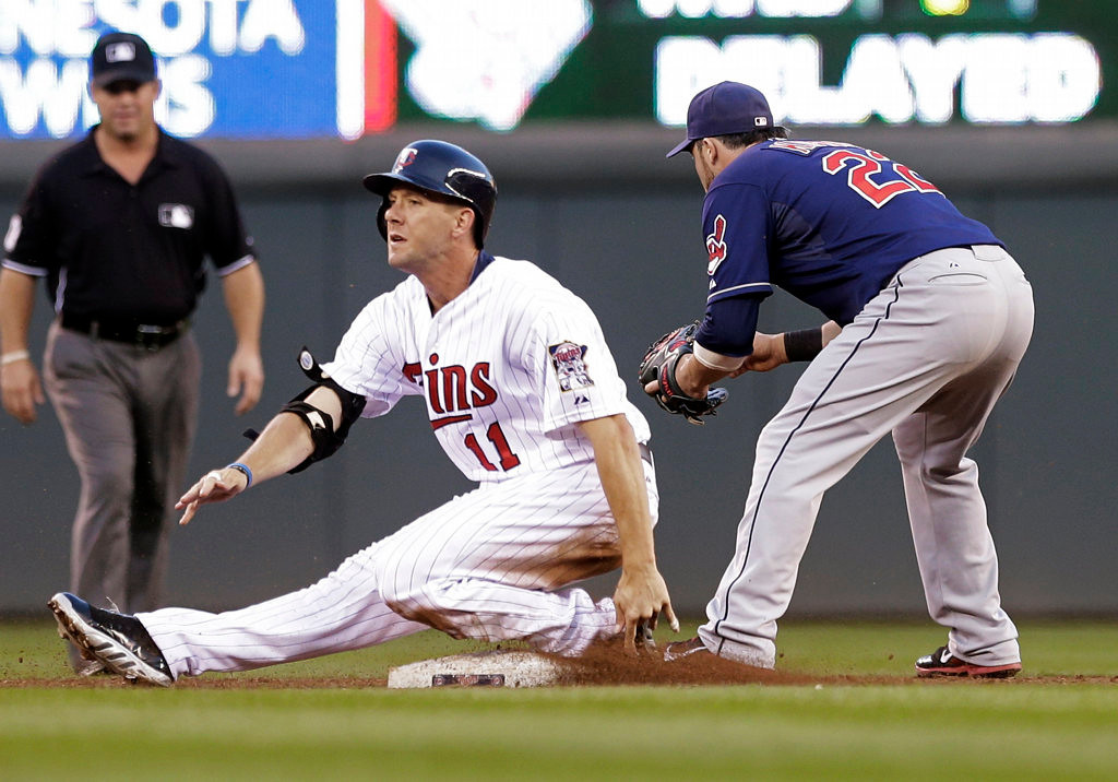 . Minnesota Twins\' Clete Thomas slides safely into second for a double as Cleveland Indians Jason Kipnis waits for the throw in the third inning. (AP Photo/Jim Mone)