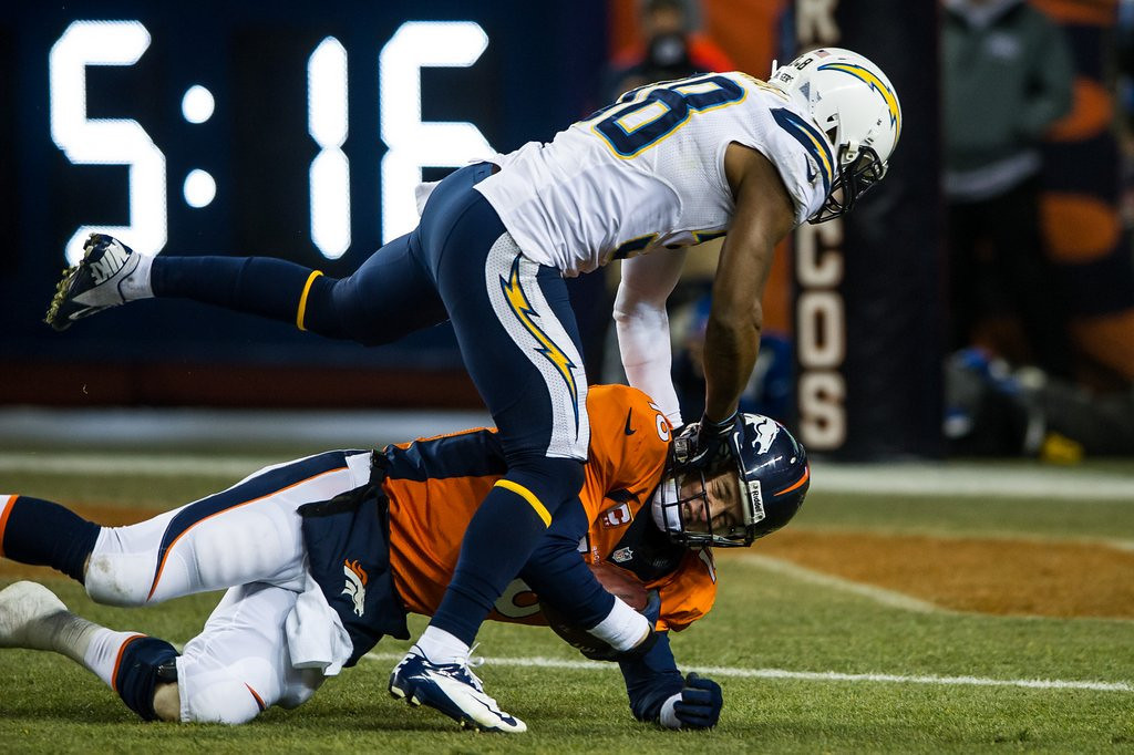. <p><b> Chargers at Broncos (-9½):</b> <p>Peyton Manning and the Broncos face a tough test just four weeks after being upset by the surging Chargers. But Denver�s home-field advantage should be even bigger now that the entire state of Colorado is, oh, about a mile high. <p>Pick: <b>Broncos by 17</b> <p>     (Dustin Bradford/Getty Images)