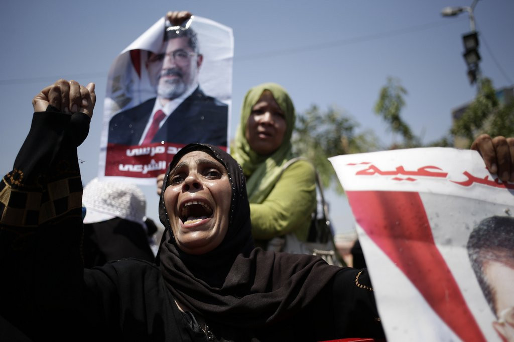 ". <p><b><a href=\'http://www.voanews.com/content/cairo-protesters-ignore-military-orders-to-disperse/1711546.html\' target=""_blank\""> 8. Egypt </a></b> <p>Things will calm down after Morsi joins Mubarak in presidential prison suite. (unranked) <p> --------------------------------------------   (AP Photo/Hassan Ammar)"