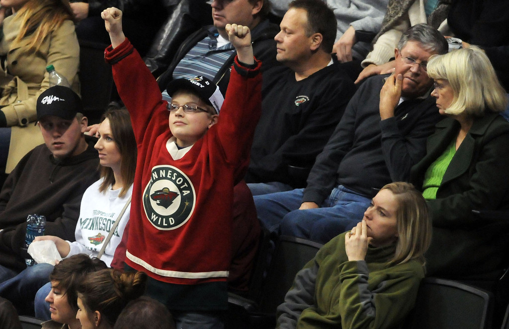 . A young wild fan cheers  in the third period as the Minnesota Wild lost 7-3 in their last game of the season against the Nashville Predators, at the Xcel Energy Center in St. Paul on April 13, 2014.  (Pioneer Press: Scott Takushi)
