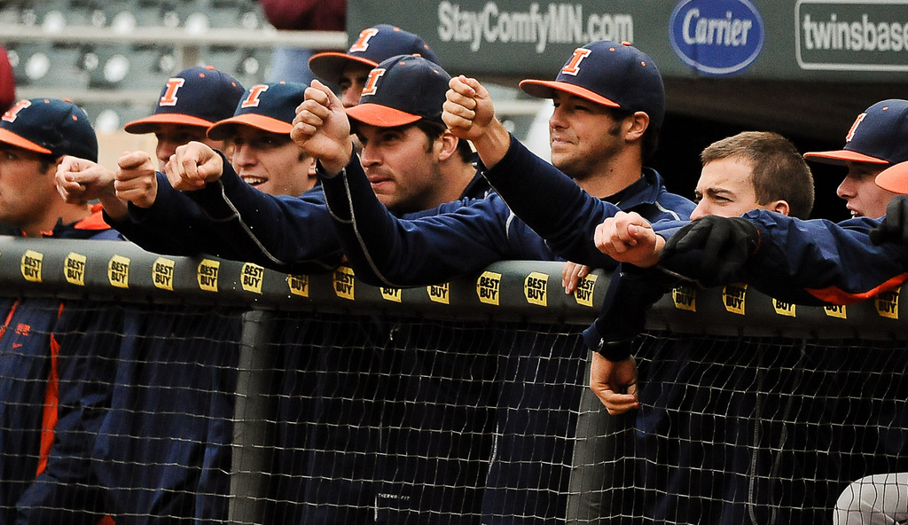 . Illinois players watch the game from the dugout rail in the second inning. (Pioneer Press: Ben Garvin)