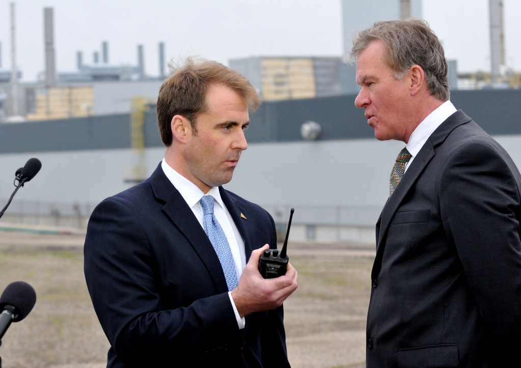 . St. Paul Councilman Chris Tolbert, left, and Mayor Chris Coleman figure out the operation of their walkie talkies as they attempt the count down to start the demoition of the Ford Plant in Highland Park on Monday morning.  (Pioneer Press: John Doman)