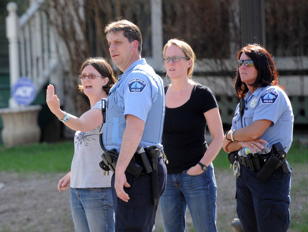 . Minneapolis police officers speak with bystanders during the investigation of the shooting. (Special to the Pioneer Press: Craig Lassig/Workingpress Photo Agency)