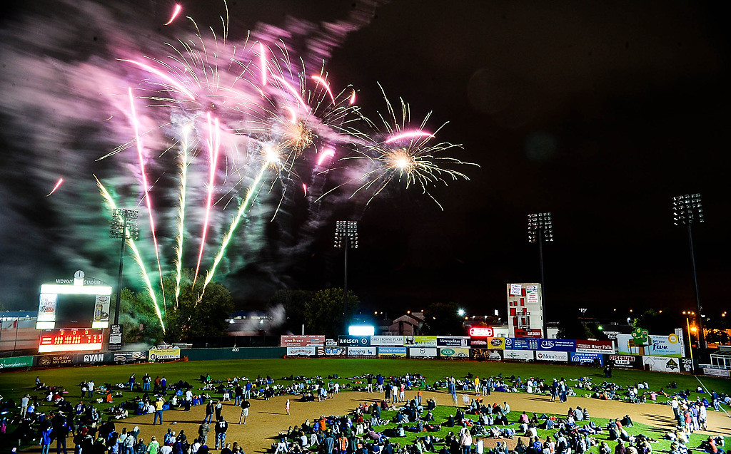 . Fans were invited to take to the field as fireworks lit up the night at the final St. Paul Saints game at Midway Stadium in St. Paul on Thursday, August 28, 2014. Next season, the Saints move to a new downtown St. Paul ballpark.(Pioneer Press: Ben Garvin)