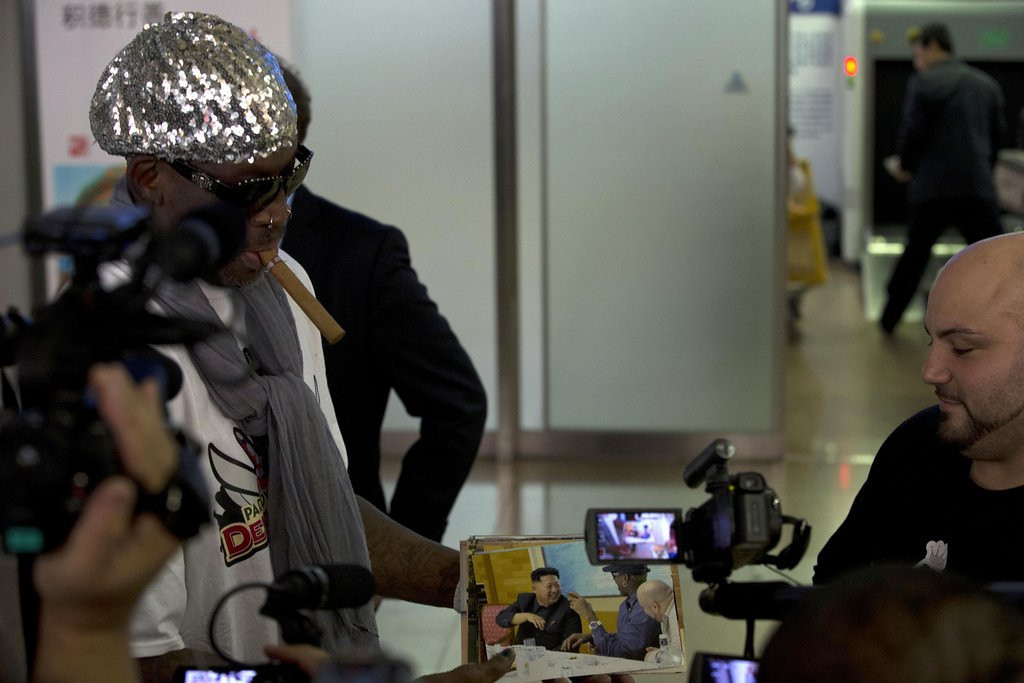 """. <p><b> Dennis Rodman this week returned to this forbidden place, where no other Americans are welcome � </b> <p> A. North Korea  <p> B. Cuba  <p> C. His home planet of Neptune  <p><b><a href=\'http://www.twincities.com/sports/ci_24050461/dennis-rodman-wants-bring-ex-nba-stars-north\' target=\""""_blank\"""">HUH?</a></b> <p>   <br> <p><b>ANSWERS</b> <p> The correct answer is always \""""A\"""" ... unless you feel very strongly otherwise. <p>  (AP Photo/Ng Han Guan)  <p>Follow Kevin Cusick on <a href=\'http://twitter.com/theloopnow\'>twitter.com/theloopnow</a>."""
