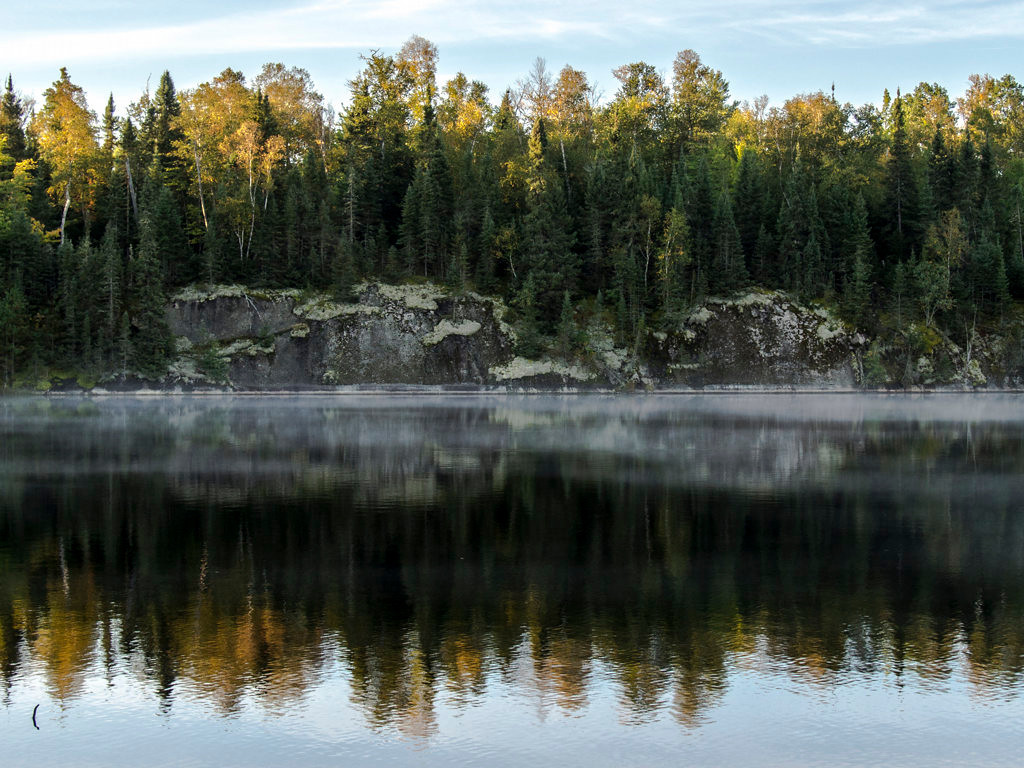 . Fog floats across Little Bass Lake in the Boundary Waters Canoe Area Wilderness just after sunrise on Sept. 23, 2013. (Pioneer Press: Andy Rathbun)