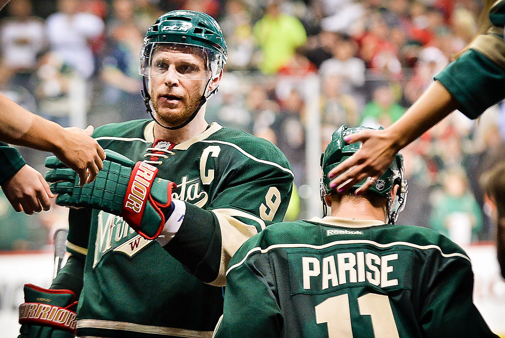 . Minnesota Wild center Mikko Koivu, left, and left wing Zach Parise were honored as players of the game.  (Pioneer Press: Ben Garvin)