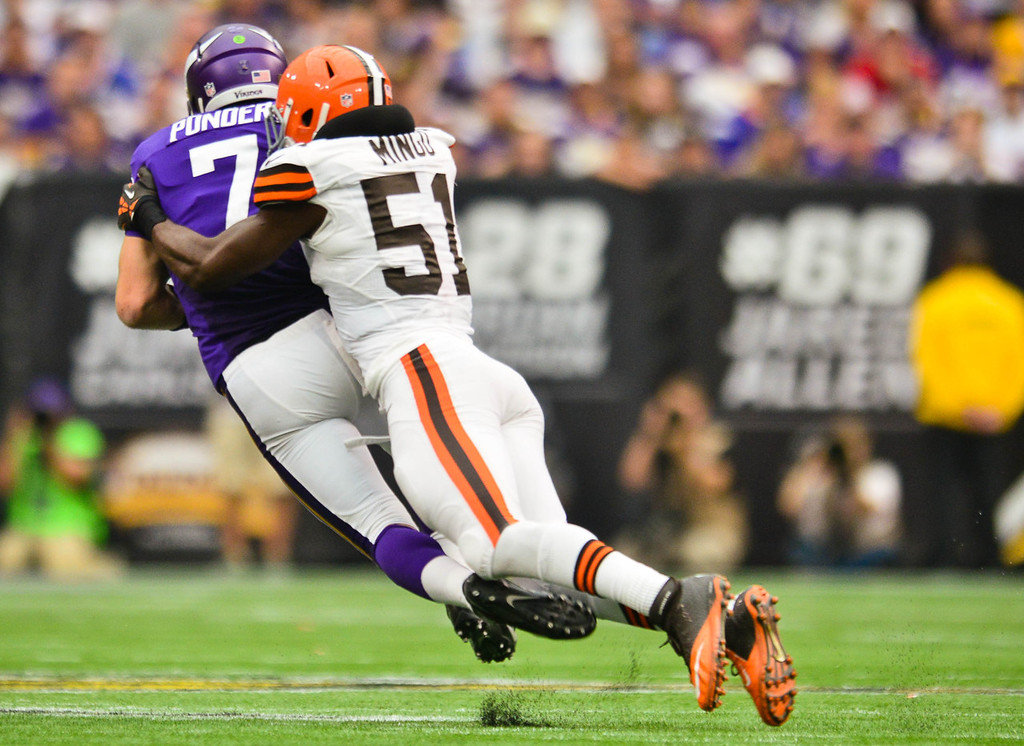 . Vikings quarterback Christian Ponder is sacked by Browns linebacker Barkevious Mingo for a 1-yard loss in the third quarter.  (Pioneer Press: Ben Garvin)