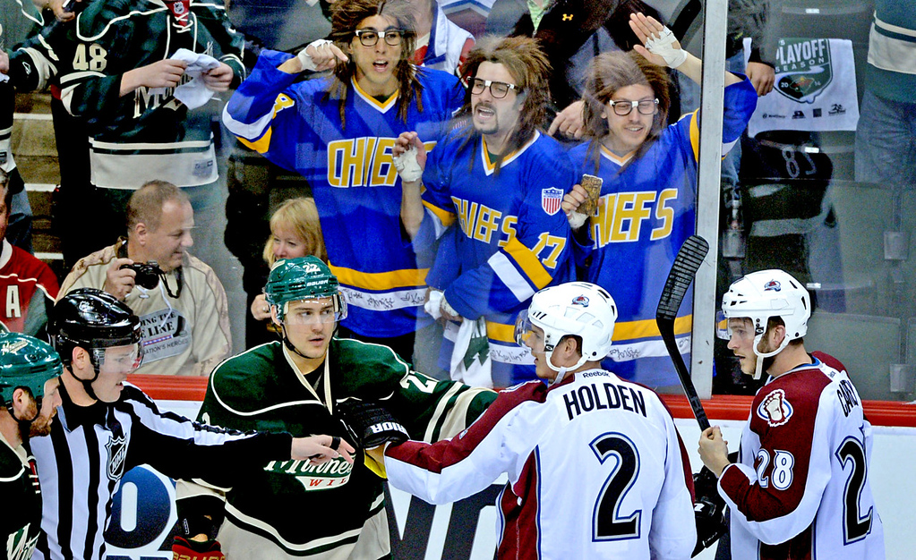 ". Minnesota\'s Nino Niederreiter, lower left, gets an assist from fans dressed up as the Hanson Brothers from the movie ""Slap Shot\"" during a scuffle with Colorado\'s Nick Holden (#2) and Paul Carey, right, during the first period. (Pioneer Press: Sherri LaRose-Chiglo)"