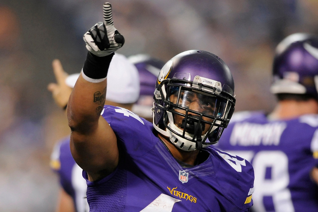 . Vikings running back Matt Asiata celebrates his one-yard touchdown run against the Titans at the start of the second quarter. (Photo by Hannah Foslien/Getty Images)