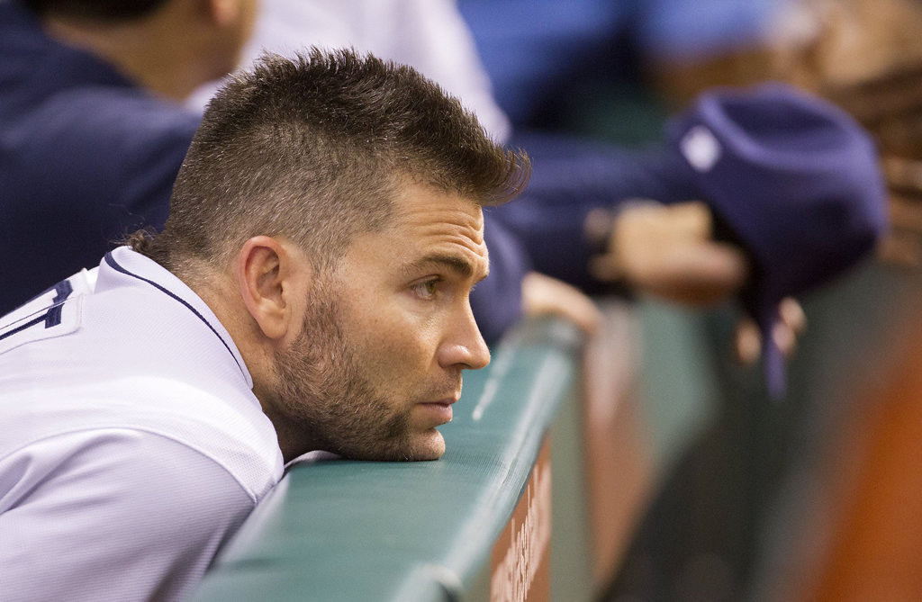 . Luke Scott of the Tampa Bay Rays watches the game from the dugout at Tropicana Field in St. Petersburg, Florida, Monday, July 8, 2013. (James Borchuck/Tampa Bay Times/MCT)