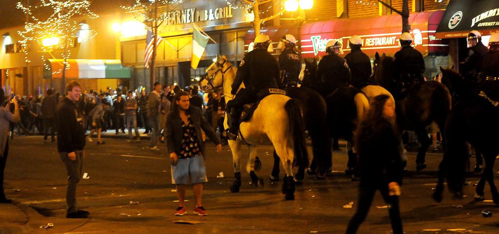 . Minneapolis Mounted Police assist in dispersing the intersection on Saturday night. (Pioneer Press: Sherri LaRose-Chiglo)