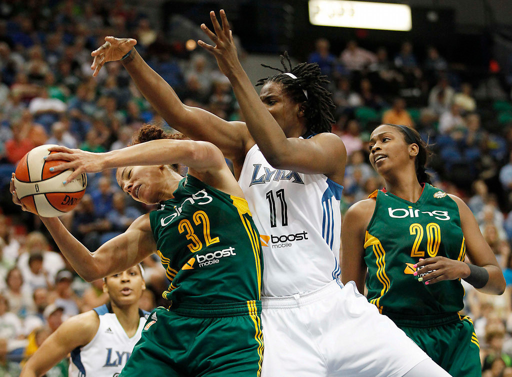 . Seattle Storm forward Alysha Clark (32) grabs a rebound from out of the reach of Minnesota Lynx forward Amber Harris (11) in the second half.  (AP Photo/Stacy Bengs)