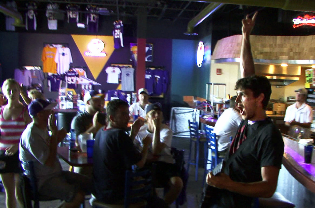 . Vikings punter Chris Kluwe celebrates after earning a perfect score while playing the video game Guitar Hero at Johnny B\'s bar in Mankato on August 1, 2008.  (Pioneer Press: Ben Garvin)