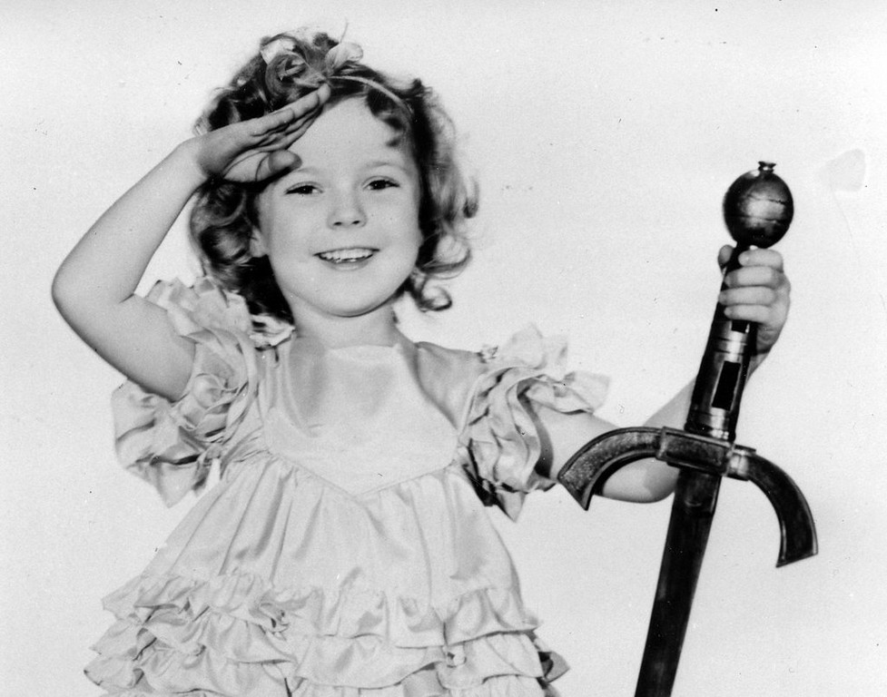 """. <p><b> The great child actress Shirley Temple died last week. She become famous overnight at 7 years of age when she � </b> <p> A. Starred in �Bright Eyes� <p> B. Appeared for the first time on Broadway <p> C. Was seduced by Woody Allen <p><b><a href=\'http://www.twincities.com/breakingnews/ci_25111118/iconic-curly-haired-child-star-shirley-temple-dies?source=hottopics\' target=\""""_blank\"""">HUH?</a></b> <p>    (AP Photo/File)"""