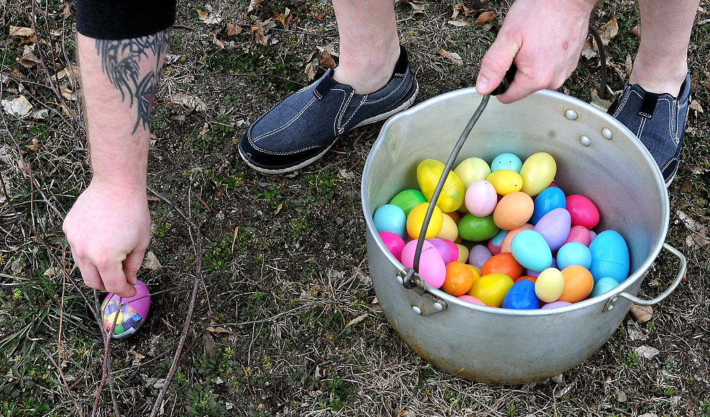 . Church volunteer Shelby Walker hides eggs for the younger egg finders. (Pioneer Press: Sherri LaRose-Chiglo)