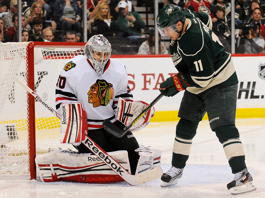 . Minnesota\'s Zach Parise, right, tries to deflect a shot past Chicago goalie Corey Crawford in the second period. (Pioneer Press: John Autey)