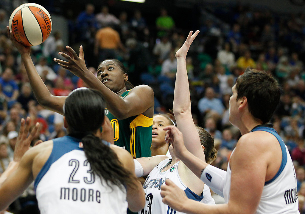 . Seattle Storm guard Shekinna Stricklen (40) goes up for shot against the defense of the Minnesota Lynx in the second half of a WNBA basketball game, Sunday, Aug. 4, 2013, in Minneapolis. The Lynx won 90-72. (AP Photo/Stacy Bengs)