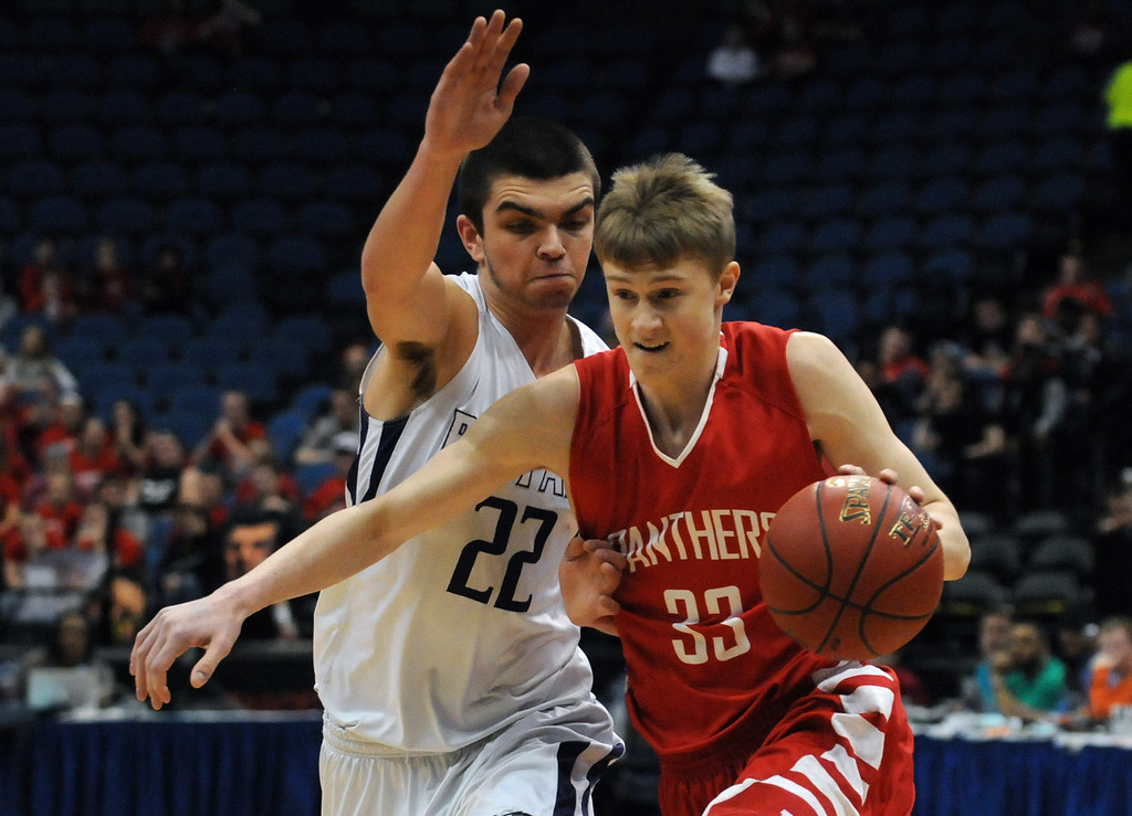. Lakeville North\'s JP Macura drives to the basket, defended by Buffalo\'s Collin Olmscheid, in the first half.  (Pioneer Press: Scott Takushi)