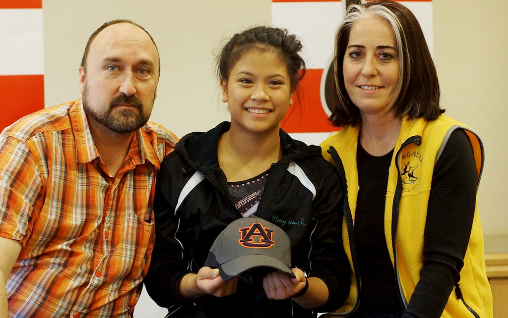 . Stillwater gymnast Mary Jane Rott poses for a photograph with her parents, Ken and Dianna Rott, after her first-place finish in the Region 4 Junior National Championships at Lindenwood College in St. Louis on April 12, 2013. (Photo courtesy Ken Rott)