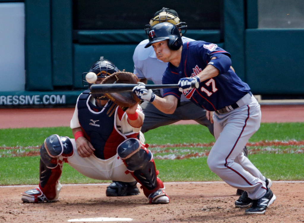 . Minnesota\'s Doug Bernier bunts for a single off Indians starter Scott Kazmir to drive in the Twins\' only run in the fifth inning. (AP Photo/Mark Duncan)