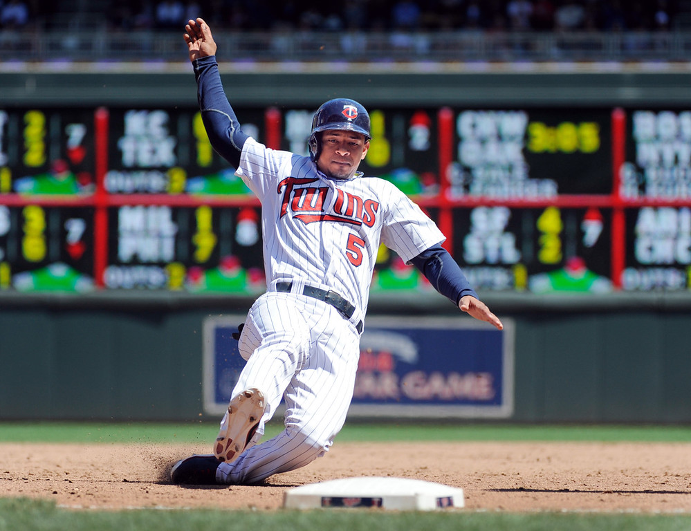 . Minnesota Eduardo Escobar motors into third on a Joe Mauer single against Seattle during the sixth inning of a baseball game, Sunday, June 2, 2013, in Minneapolis. Escobar later scored in the inning on a Josh Willingham single. (AP Photo/Craig Lassig)