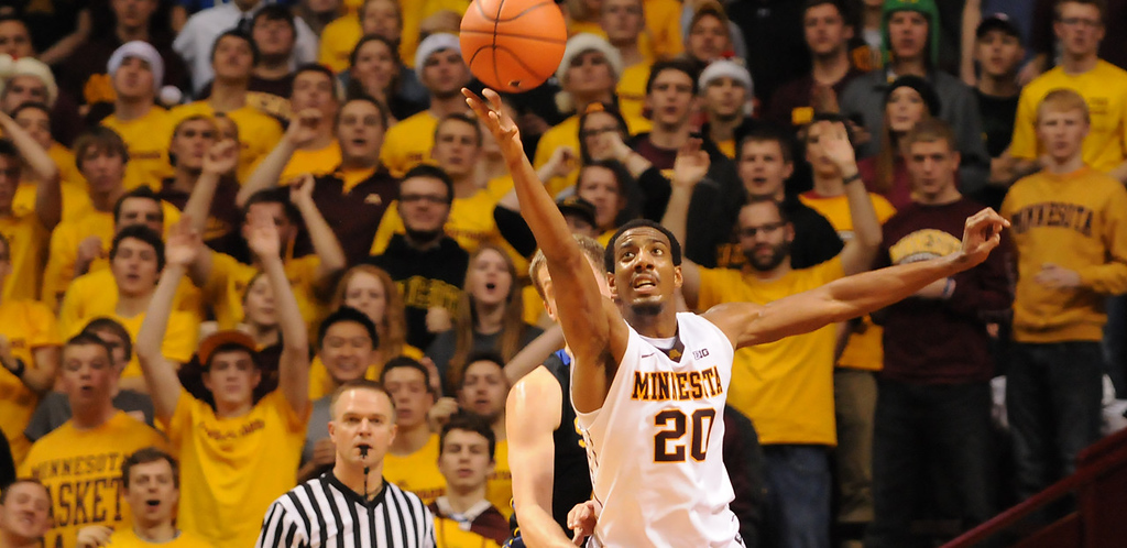 . Minnesota guard Austin Hollins grabs an offensive rebound against South Dakota State in the first half at Williams Arena, Tuesday, Dec. 10, 2013. The Gophers beat the Jackrabbits 75-59 as Hollins finished with 20 points and 14 rebounds to reach 1000 career points. (Pioneer Press: John Autey)