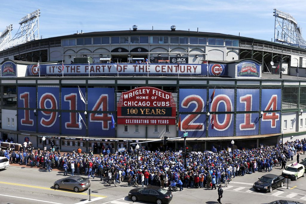 ". <p><b> Chicago Cubs fans turned out at the Friendly Confines last week to help celebrate the 100th anniversary of � </b> <p> A. The first game at Wrigley Field <p> B. The Cubs franchise <p> C. The Cubs� last winning season <p><b><a href=\'http://www.twincities.com/sports/ci_25620184/scorekeeper-at-wrigley-practices-dying-art\' target=""_blank\""> LINK </a></b> <p>   (AP Photo/Charles Rex Arbogast)"