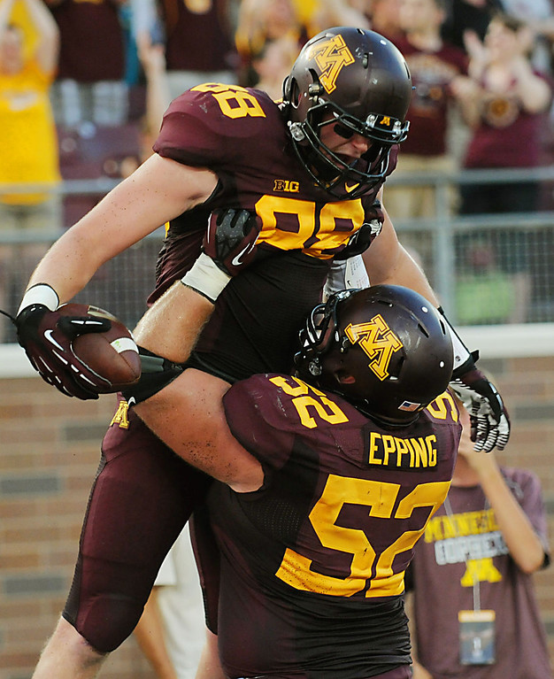 . Minnesota tight end Maxx Williams is lifted by offensive lineman Zac Epping after catching a pass for a touchdown late in the second quarter. (Pioneer Press: John Autey)