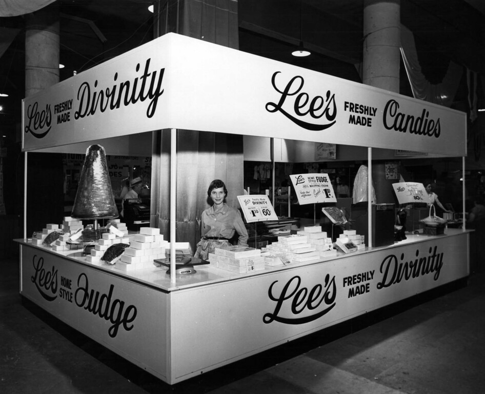 . A woman stands at the concession stand of Lee\'s Freshly Made Candies during the Minnesota State Fair in 1955. A pound of divinity fudge costs $1.20. Photo courtesy of the Minnesota State Fair.