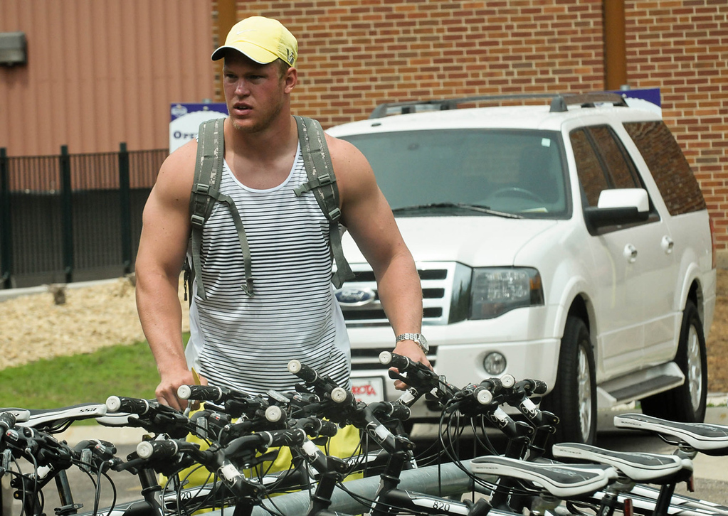 . Vikings tight end Kyle Rudolph gets ready to jump on his bike after arriving at training camp in Mankato.  (Pioneer Press: Ben Garvin)