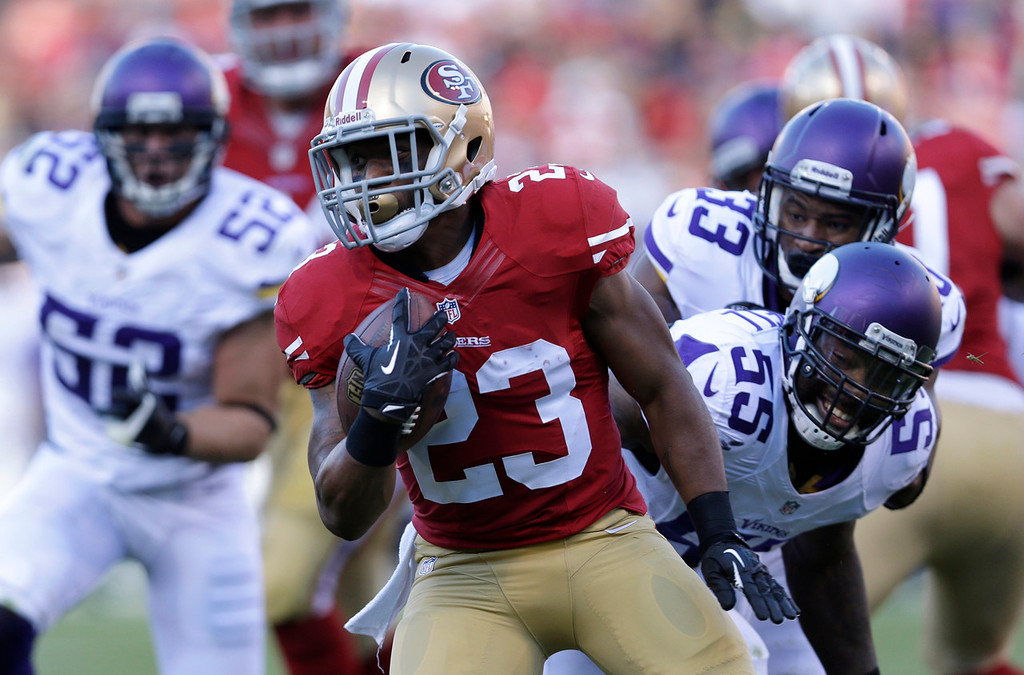 . 49ers running back LaMichael James twists past Vikings defenders (from left) Chad Greenway, Jamarca Sanford and Marvin Mitchell during the second quarter. (AP Photo/Marcio Jose Sanchez)