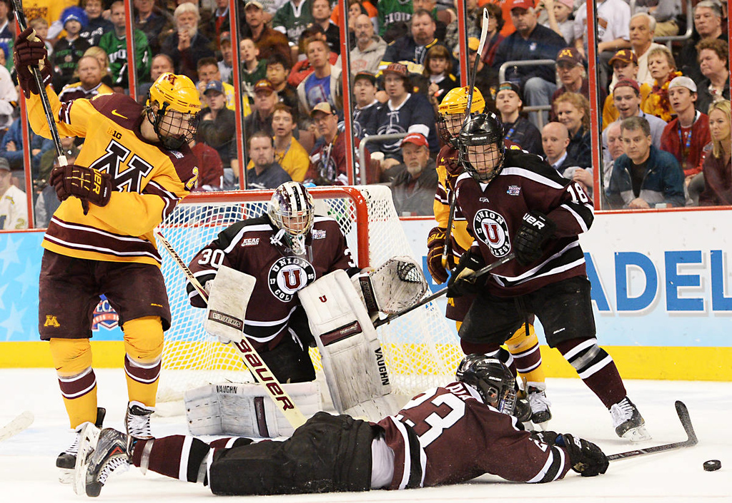 . Union College senior forward Cole Ikkala ties to bat the puck away from Minnesota freshman forward Hudson Fasching who was winding up to take a shot at Union College junior goalie Colin Stevens in the second period of the NCAA Frozen Four Championship Game at the Wells Fargo Center in Philadelphia, Saturday, April 12, 2014.  (Pioneer Press: John Autey)