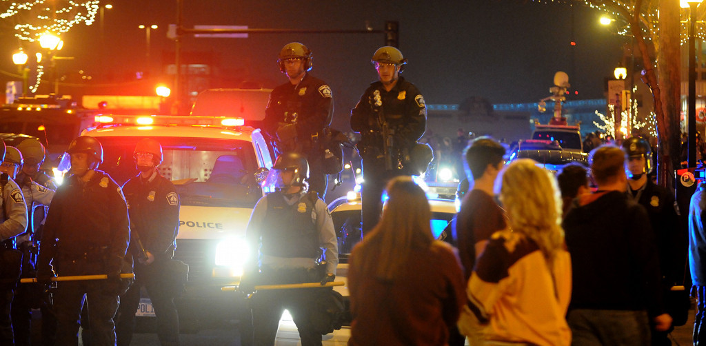 . Minneapolis police watch the crowd as things begin to get out of hand on Saturday night. (Pioneer Press: Sherri LaRose-Chiglo)