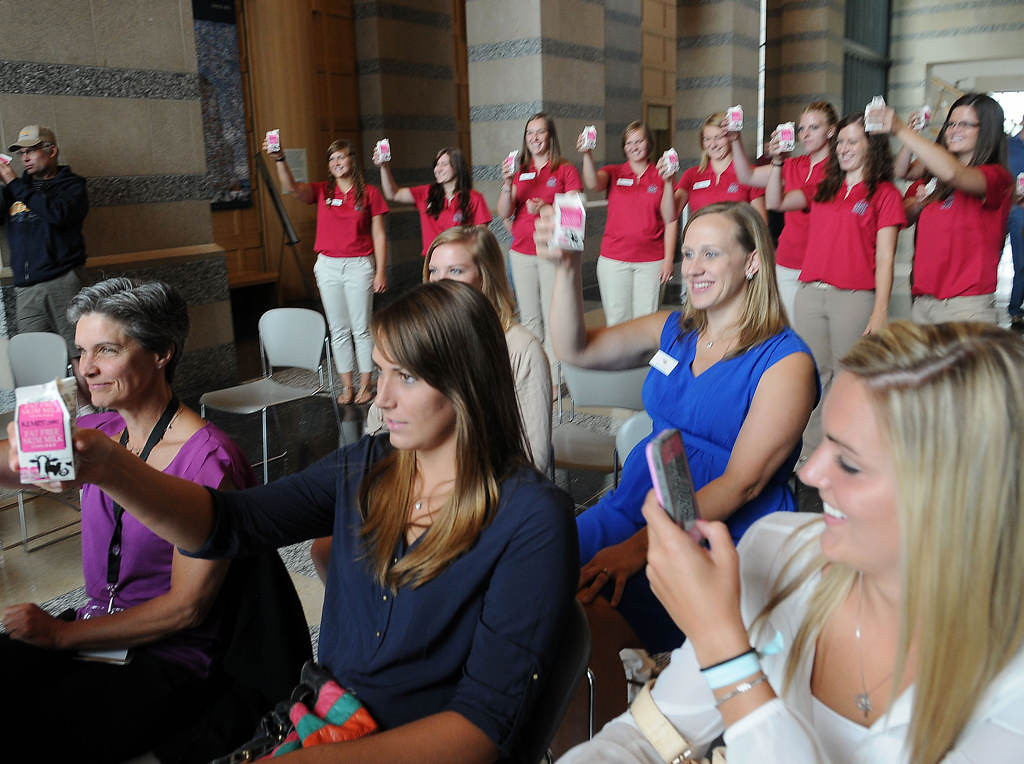 . Princess Kay candidates, back, and former Princess Kays, front, share a milk toast while gathered at the Minnesota History Center.  (Pioneer Press: Sherri LaRose-Chiglo)