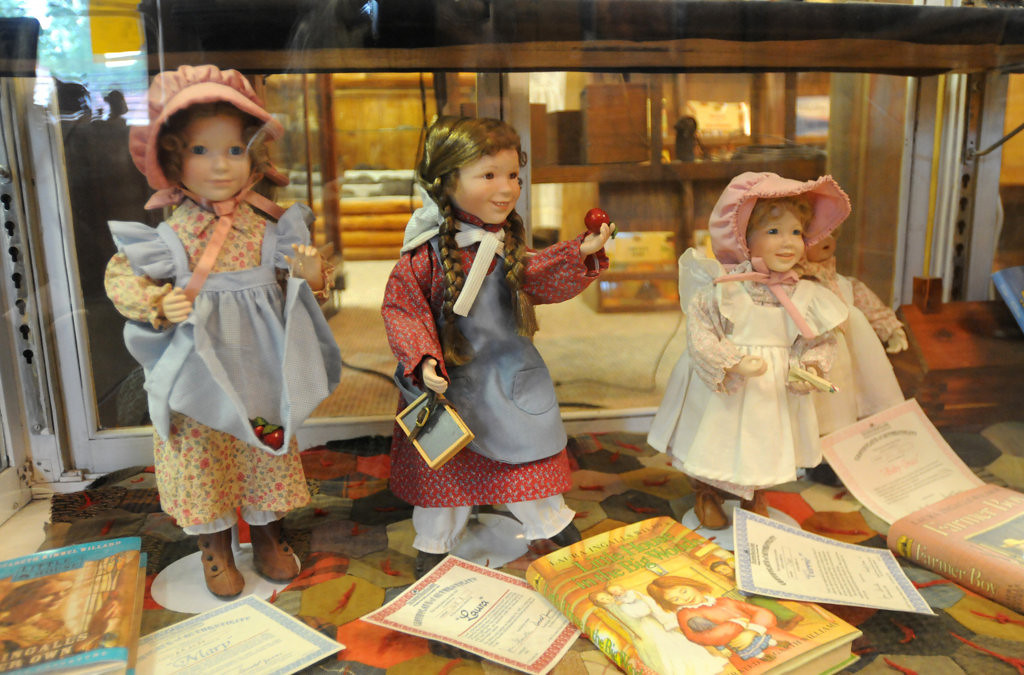 """. Limited edition dolls made by The Ashton-Drake Galleries, not for sale are displayed at the Little House Wayside Museum in Pepin, Wisconsin.  The books by Laura Ingalls Wilder helped make the region famous. Sisters represented are from left: Mary, Laura and Carrie Ingalls. About 7 miles up the road from the Museum is a replica of \""""Little House in the Big Woods\"""" one of the many homes that Laura wrote about in her series of books for children. (Pioneer Press: Ginger Pinson)"""