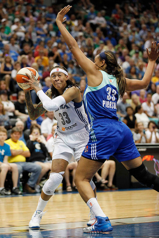 . Minnesota Lynx guard Seimone Augustus protects the ball against New York Liberty forward Plenette Pierson in the second half. (AP Photo/Stacy Bengs)