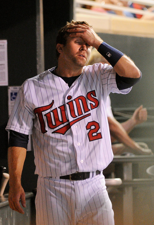 . Minnesota second baseman Brian Dozier rubs his head in the dugout after he flied out during the seventh inning. (Pioneer Press: John Autey)