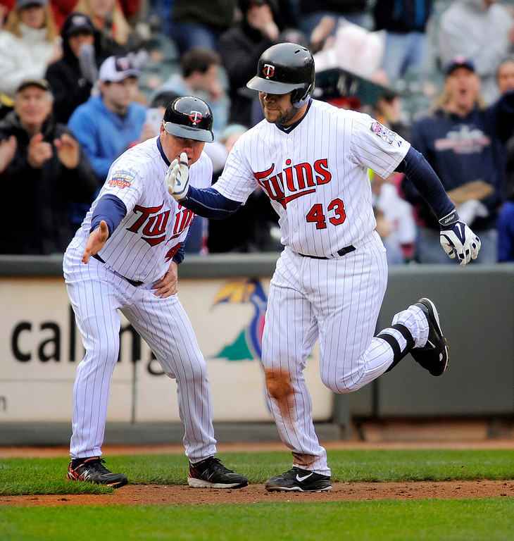 . Minnesota Twins� Josmil Pinto (43) gets congratulations from third base coach Joe Vavra, left, after hitting a two-run home run during the seventh inning. (AP Photo/Tom Olmscheid)