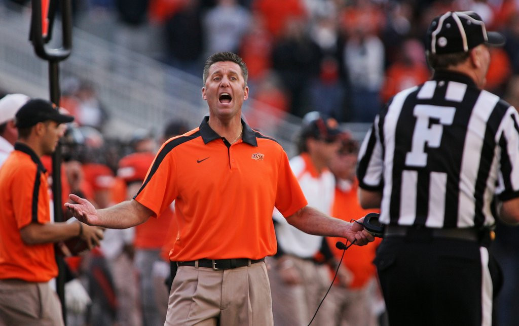 """. <p><b> A shocking report in Sports Illustrated has unearthed a pay-for-play scandal at � </b> <p> A. Oklahoma State  <p> B. Oklahoma  <p> C. Every football program in the Southeastern Conference  <p><b><a href=\'http://sportsillustrated.cnn.com/college-football/news/20130910/oklahoma-state-part-1-money/\' target=\""""_blank\"""">HUH?</a></b> <p>     (Brett Deering/Getty Images)"""