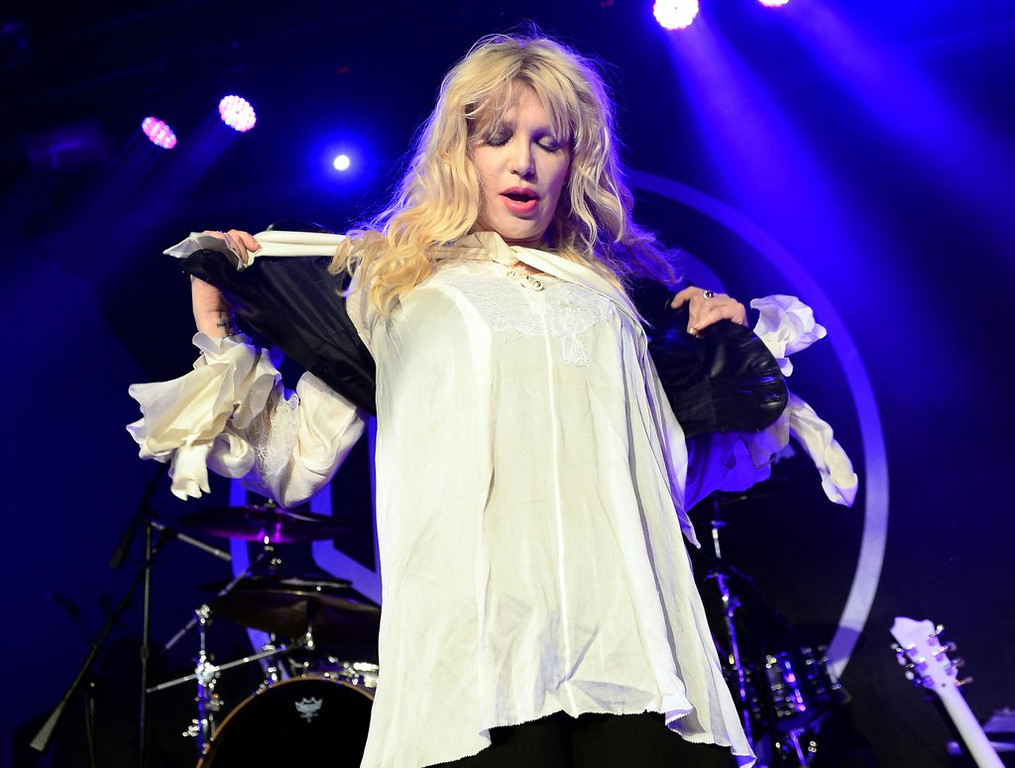 """. <p>10. (tie) COURTNEY LOVE <p>Knows where Malaysian jet landed, because she can see it from her planet. (previous ranking: unranked) <p><b><a href=\'http://www.cnn.com/2014/03/18/showbiz/celebrity-news-gossip/courtney-love-missing-plane/\' target=\""""_blank\""""> HUH?</a></b> <p>    (Ethan Miller/Getty Images)"""
