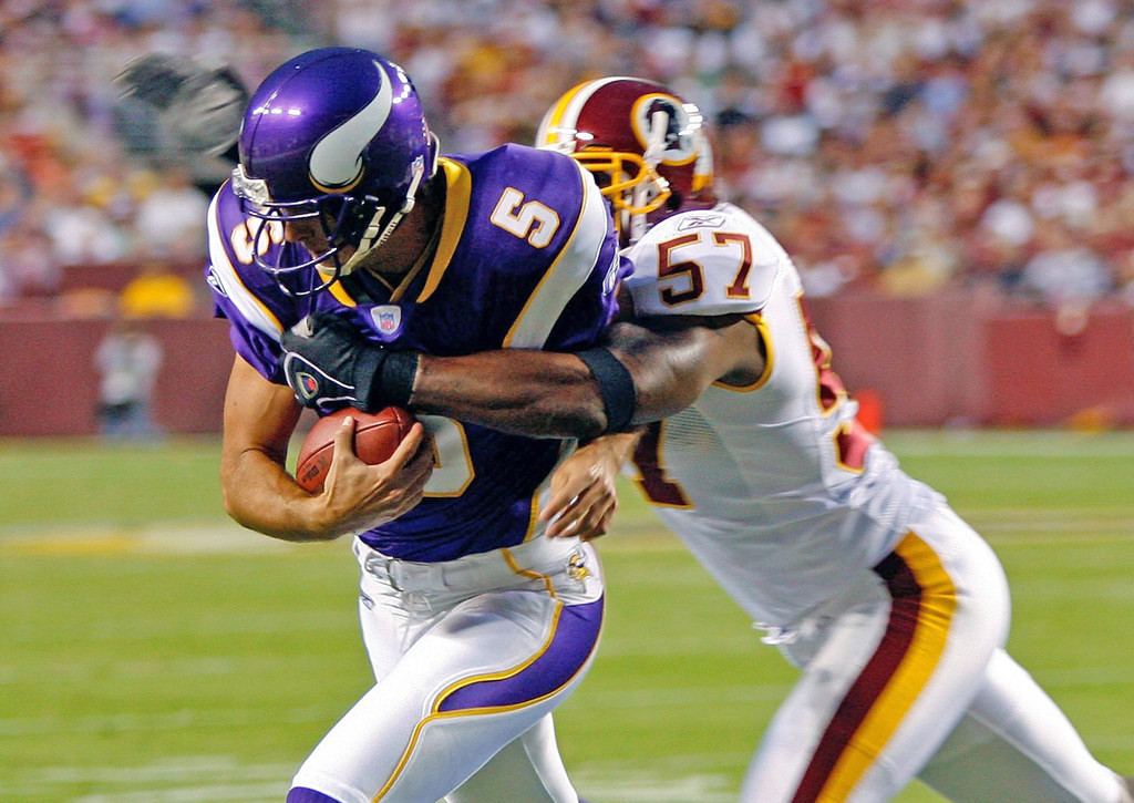 . Minnesota\'s Chris Kluwe  is tackled by Washington\'s Warrick Holdman on a missed extra point during the first Monday Night Football game of the season on September 11, 2006 at FedEx Field in Landover, Maryland.  (Photo by Win McNamee/Getty Images)